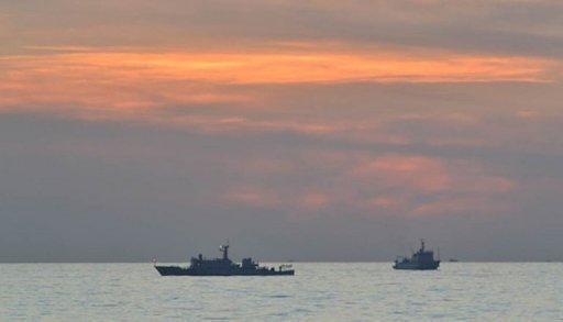 A Chinese surveillance ship is seen off Scarborough Shoal in the South China Sea on April 11. The Philippine military has accused China of sending more ships to a disputed shoal in the South China Sea, describing the move as an insult that would further inflame tensions