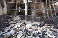 This photo released by Indonesian Ministry of Justice and Human Rights shows debris inside a charred prison cell after a fire at Tangerang Prison in Tangerang, Indonesia, Wednesday, Sept. 8, 2021. A massive fire raged through the overcrowded prison near Indonesia's capital early Wednesday, killing a number of inmates.(Indonesian Ministry of Justice and Human Rights via AP)