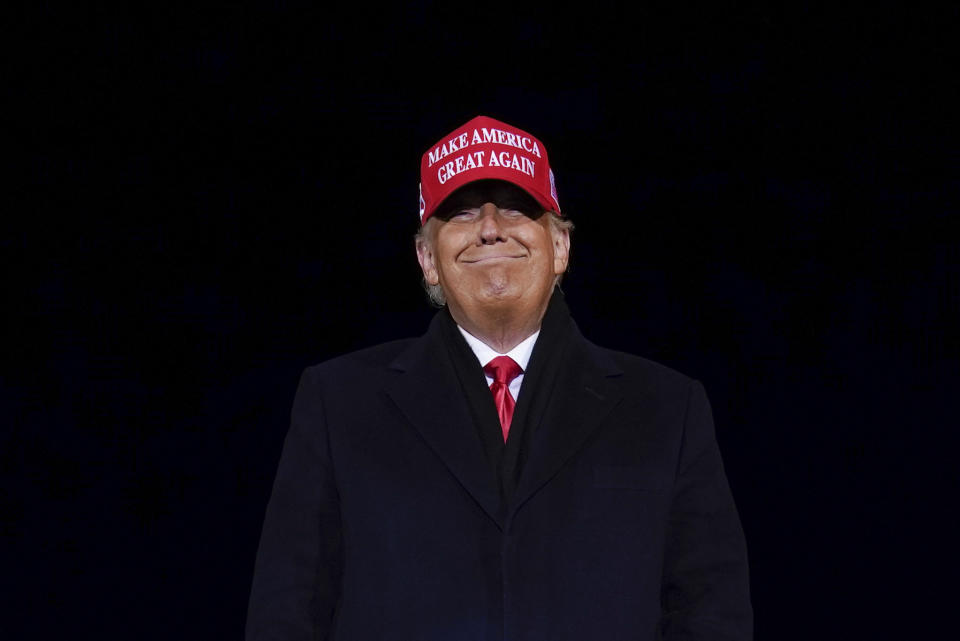 President Donald Trump smiles at supporters after a campaign rally at Gerald R. Ford International Airport, early Tuesday, Nov. 3, 2020, in Grand Rapids, Mich. (AP Photo/Evan Vucci)
