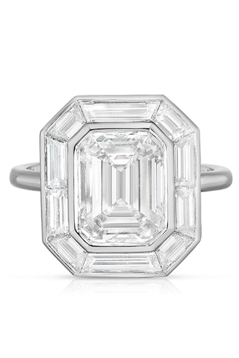 "<p><strong><em>Marisa Perry by Douglas Elliott</em></strong><em> ""Emerald-Cut Diamond Deco Dream Engagement Ring,"" price upon request, <a href=""https://www.marisaperry.com/the-emerald-cut-diamond-deco-dream-2-0-platinum-marisa-perry-by-douglas-elliott/"" rel=""nofollow noopener"" target=""_blank"" data-ylk=""slk:marisaperry.com"" class=""link rapid-noclick-resp"">marisaperry.com</a></em></p><p><a class=""link rapid-noclick-resp"" href=""https://www.marisaperry.com/the-emerald-cut-diamond-deco-dream-2-0-platinum-marisa-perry-by-douglas-elliott/"" rel=""nofollow noopener"" target=""_blank"" data-ylk=""slk:SHOP"">SHOP</a></p>"