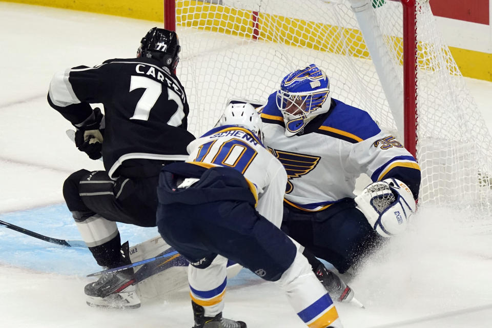 Los Angeles Kings center Jeff Carter (77) scores past St. Louis Blues goaltender Ville Husso (35) during the second period of an NHL hockey game Friday, March 5, 2021, in Los Angeles. (AP Photo/Marcio Jose Sanchez)