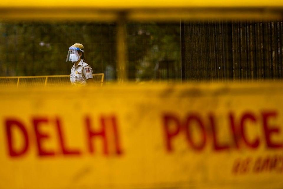 File: A police officer stands guard at a roadblock in Delhi on 20 April, 2021 (AFP via Getty Images)