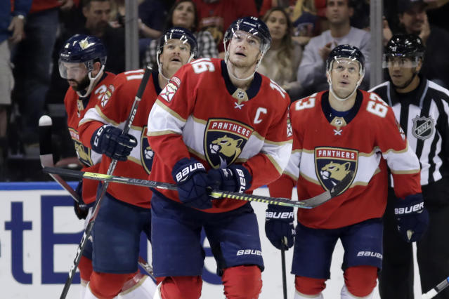Florida Panthers center Aleksander Barkov (16) looks up at the scoreboard after scoring goal during the first period of the team's NHL hockey game against the Detroit Red Wings, Saturday, Nov. 2, 2019, in Sunrise, Fla. (AP Photo/Lynne Sladky)