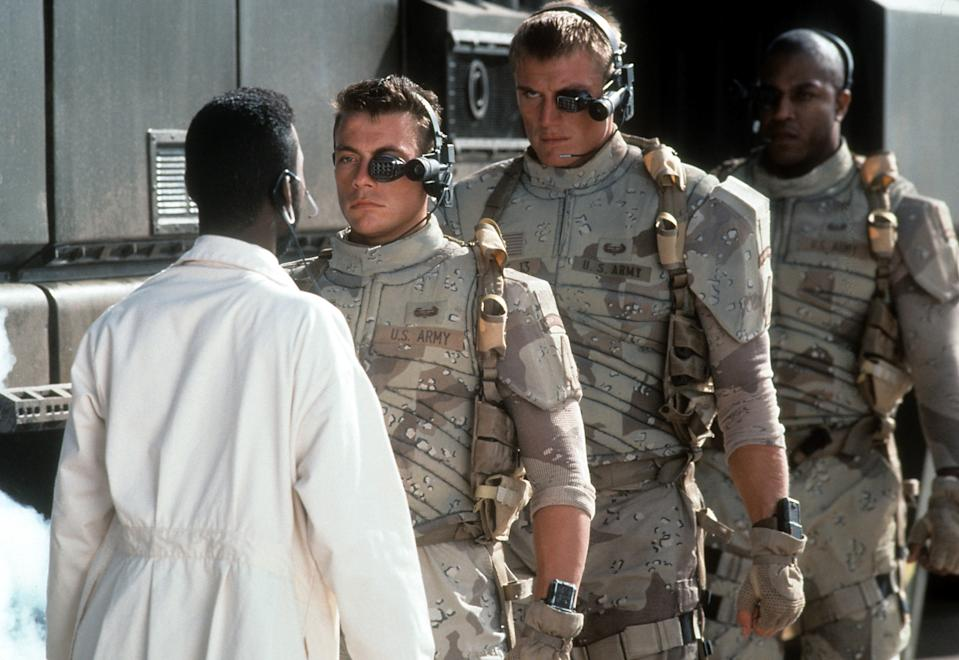Jean Claude Van Damme, Dolph Lundgren and Tommy 'Tiny' Lister line up in a scene from the film 'Universal Soldier', 1992. (Photo by TriStar/Getty Images)