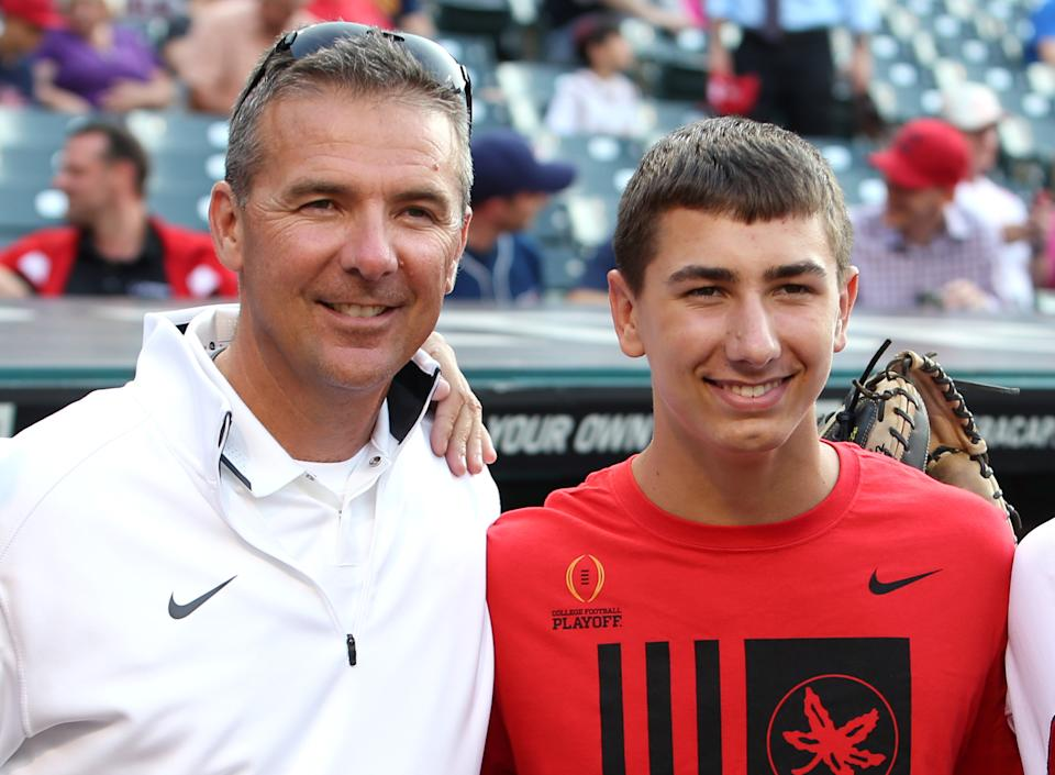 Then-Ohio State coach Urban Meyer, left, poses with his son Nate on Tuesday, June 9, 2015. (AP)