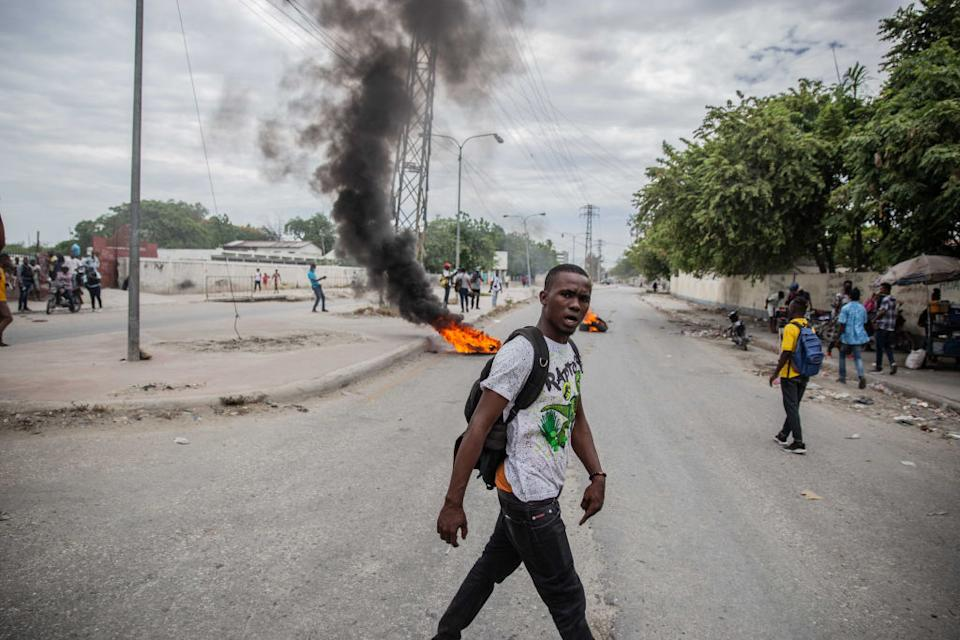 Supporters of political leaders being questioned by authorites protest in the street. Source: Getty