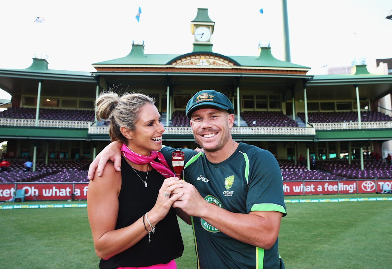 SYDNEY, AUSTRALIA - JANUARY 05:  David Warner of Australia and his partner Candice Falzon pose with the urn during day three of the Fifth Ashes Test match between Australia and England at Sydney Cricket Ground on January 5, 2014 in Sydney, Australia.  (Photo by Ryan Pierse/Getty Images)