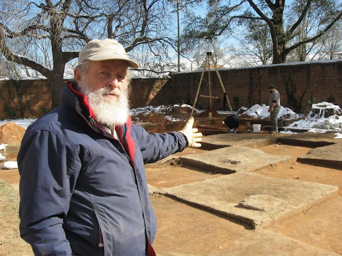 """In this Jan. 30, 2014 photo, University of South Carolina research archaeologist Chester DePratter stands by the archaeological dig of """"Camp Asylum,"""" the Civil War-era prison that once held 1,500 Union officers on the grounds of the state mental hospital in Columbia, S.C., in the waning days of the Civil War. Racing against time, South Carolina archeologists are digging to uncover the remnants of a Civil War-era prisoner-of-war camp before the site in downtown Columbia is cleared to make room for a mixed-use development. (AP Photo/Susanne Schafer)"""