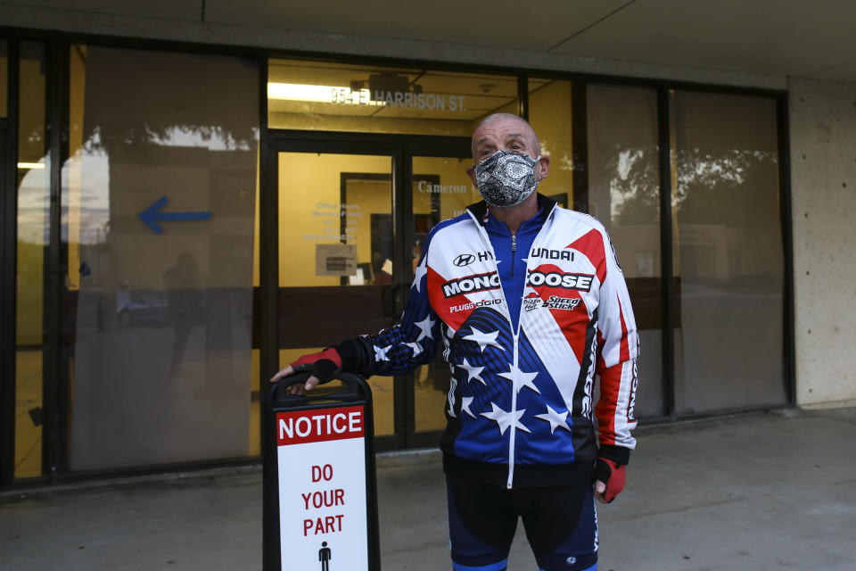 Scott McQuarrie waits outside Tuesday, Nov. 3, 2020, before the official opening of the poll for Election Day at the Cameron County Judicial Complex in Brownsville, Texas.(Denise Cathey/The Brownsville Herald via AP)/The Brownsville Herald via AP)