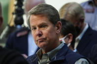 Georgia Gov. Brian Kemp listens to a question during a news conference at the State Capitol on Saturday, April 3, 2021, in Atlanta, about Major League Baseball's decision to pull the 2021 All-Star Game from Atlanta over the league's objection to a new Georgia voting law. (AP Photo/Brynn Anderson)