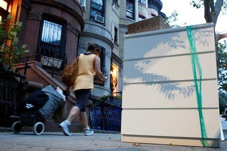An Ikea MALM dresser is placed by the road in a Brooklyn neighborhood of New York