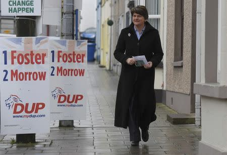 Foster, leader of the DUP walks towards a polling station in the Northern Ireland Assembly elections in Brookeborough in Northern Ireland