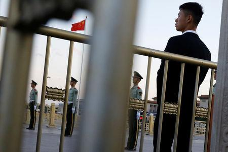 Security officers keep watch at Tiananmen Square in Beijing, China May 19, 2019. REUTERS/Thomas Peter