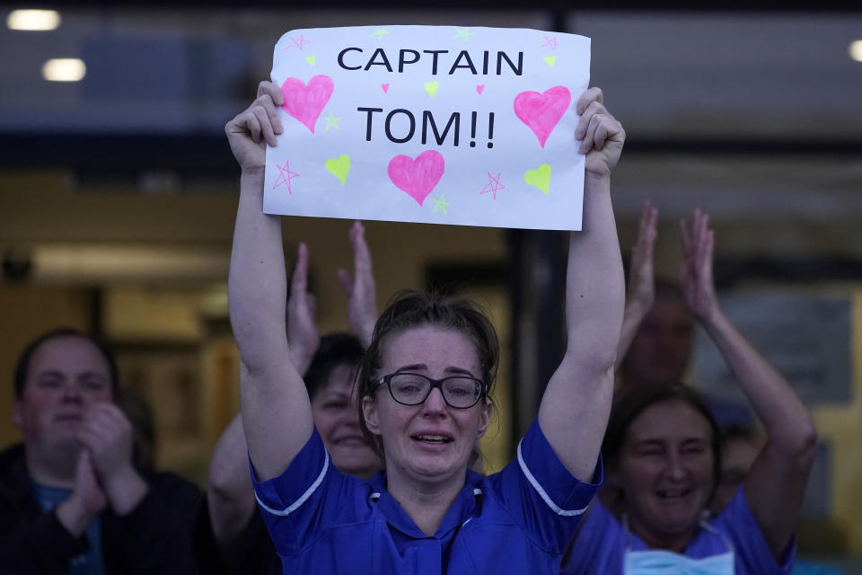"""LIVERPOOL,  UNITED KINGDOM- APRIL 16:  A nurse at Aintree University Hospital sheds a tear and as she pays tribute to super fundraiser Captain Tom Moore during the """"Clap for Our Carers"""" and the NHS on April 16, 2020 in Liverpool, United Kingdom. Following the success of  the """"Clap for Our Carers"""" campaign, members of the public are being encouraged to applaud NHS staff and other key workers from their homes at 8pm every Thursday. The Coronavirus (COVID-19) pandemic has infected over 2 million people across the world, claiming at least 13,729 lives in the U.K. (Photo by Christopher Furlong/Getty Images)"""