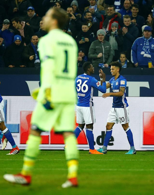 Soccer Football - Bundesliga - Schalke 04 vs TSG 1899 Hoffenheim - Veltins-Arena, Gelsenkirchen, Germany - February 17, 2018 Schalke's Thilo Kehrer celebrates with Breel Embolo after scoring their first goal REUTERS/Leon Kuegeler DFL RULES TO LIMIT THE ONLINE USAGE DURING MATCH TIME TO 15 PICTURES PER GAME. IMAGE SEQUENCES TO SIMULATE VIDEO IS NOT ALLOWED AT ANY TIME. FOR FURTHER QUERIES PLEASE CONTACT DFL DIRECTLY AT + 49 69 650050
