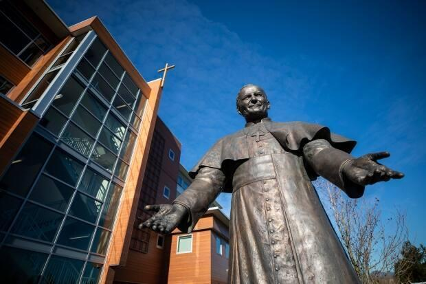 A statue of Pope John Paul II welcomes visitors to the Catholic Archdiocese of Vancouver. The archdiocese is facing a lawsuit from a B.C. man who claims he was sexually assaulted in the late 70s at a summer camp run by the church. (Ben Nelms/CBC - image credit)