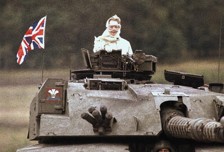 """FILE - In this Sept. 17, 1986 file photo, British Prime Minister Margaret Thatcher stands in a British tank during a visit to British forces in Fallingbostel, some 120km (70 miles) south of Hamburg, Germany. Thatcher's former spokesman, Tim Bell, said the former prime minister, known to both friends and foes as """"The Iron Lady,"""" died of a stroke Monday morning, April 8, 2013. She was 87. (AP Photo/Jockel Fink, File)"""
