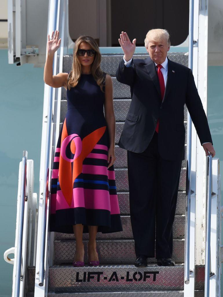 <p>FLOTUS opted for a bold, brightly colored dress by Delpozo while visiting Poland. The ankle-length, sleeveless dress was solid navy at the top with hot pink designs on the skirt.</p>