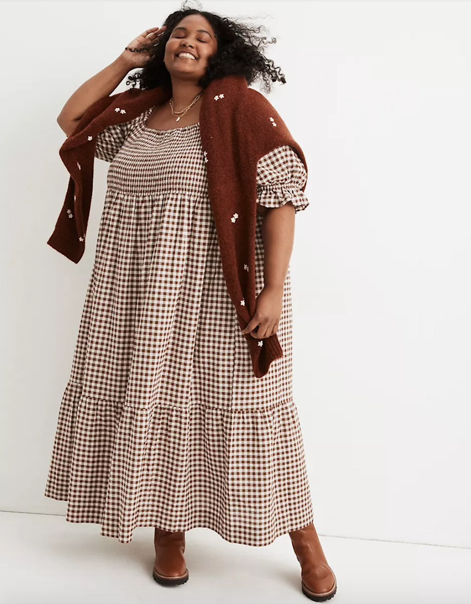 """<h2>Madewell Lucie Elbow-Sleeve Smocked Midi Dress</h2><br><strong><em>The Cottagecore Choice</em></strong><br><br>All those English countryside ensembles that resulted from <a href=""""https://www.refinery29.com/en-us/the-nap-dress-best-styles"""" rel=""""sponsored"""" target=""""_blank"""" data-ylk=""""slk:the nap dress phenomenon"""" class=""""link rapid-noclick-resp"""">the nap dress phenomenon</a> aren't going anywhere... at least not any time soon. If you're late to the trend, consider scooping up Madewell's best-selling iteration in a fall-friendly gingham print.<br><br><strong>The Hype: </strong>4.5 out of 5 stars; 5 reviews on Madewell.com<br><br><strong>What They're Saying</strong>: """"This dress is perfect! I hoped to purchase the blue daisy print but it was backordered until November and I'm happy it is because this print is perfect for Fall. Drapes perfectly, material is amazing, super-flattering style. Love love love it!""""— Heathl, Madewell reviewer<br><br><em>Shop</em> <strong><em><a href=""""https://www.madewell.com/lucie-elbow-sleeve-smocked-midi-dress-in-gingham-NB355.html"""" rel=""""sponsored"""" target=""""_blank"""" data-ylk=""""slk:Madewell"""" class=""""link rapid-noclick-resp"""">Madewell</a></em></strong><br><br><strong>Madewell</strong> Lucie Elbow-Sleeve Smocked Midi Dress in Gingham, $, available at <a href=""""https://go.skimresources.com/?id=30283X879131&url=https%3A%2F%2Fwww.madewell.com%2Flucie-elbow-sleeve-smocked-midi-dress-in-gingham-NB355.html"""" rel=""""sponsored"""" target=""""_blank"""" data-ylk=""""slk:Madewell"""" class=""""link rapid-noclick-resp"""">Madewell</a>"""