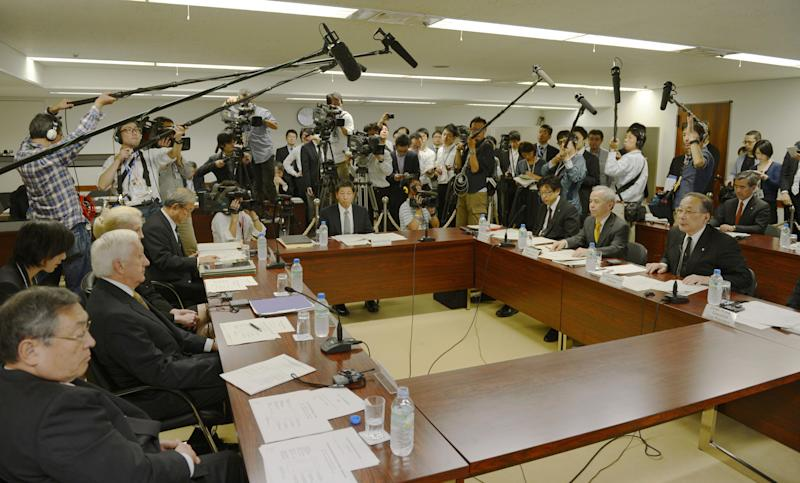 Former U.S. nuclear regulatory chief Dale Klein, second from left, attends the first internal reform committee meeting held by Tokyo Electric Power Co. (TEPCO) at its headquarters in Tokyo Friday, Oct. 12, 2012. Dale's five-member committee oversees the task force's reform plans, which aim to use the lessons learned at TEPCO's Kashiwazaki-Kariwa plant in northern Japan. The cash-strapped utility wants to restart that plant, but TEPCO officials denied the reform plans are aimed at improving public image to gain support for the plant's resumption. (AP Photo/Kyodo News) JAPAN OUT, MANDATORY CREDIT, NO LICENSING IN CHINA, FRANCE, HONG KONG, JAPAN AND SOUTH KOREA
