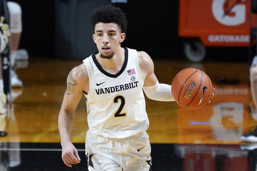 Vanderbilt guard Scotty Pippen Jr. (2) brings the ball down the court against Mississippi State in the first half of an NCAA college basketball game Saturday, Jan. 9, 2021, in Nashville, Tenn. (AP Photo/Mark Humphrey)