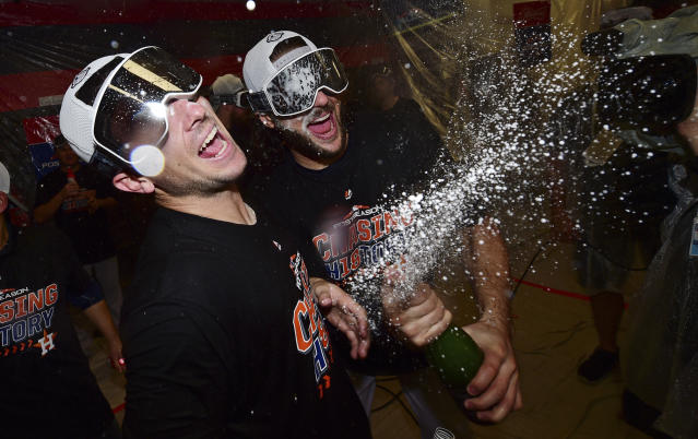 Houston Astros' Alex Bregman, left, and Jake Marisnick celebrate after defeating the Cleveland Indians 11-3 in Game 3 of a baseball American League Division Series, Monday, Oct. 8, 2018, in Cleveland. (AP Photo/David Dermer)