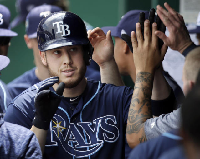 Tampa Bay Rays designated hitter C.J. Cron is congratulated by teammates after hitting a solo home run off Kansas City Royals starting pitcher Jason Hammel during the third inning of a baseball game at Kauffman Stadium in Kansas City, Mo., Wednesday, May 16, 2018. (AP Photo/Orlin Wagner)