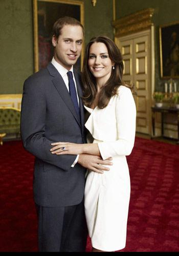 Kate wears a beautiful white Reiss dress in one of two official portrait photographs taken by famed fashion photograher, Mario Testine, on Nov. 25, 2010. The dress sold out in minutes and was re-issued to accomodate all the requests. (AP Photo/Clarence House Press Office/Copyright 2010 Mario Testino)