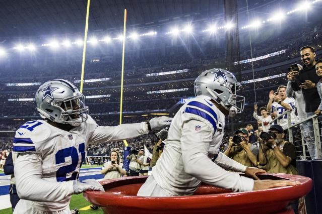 "The NFL fined <a class=""link rapid-noclick-resp"" href=""/nfl/teams/dal"" data-ylk=""slk:Cowboys"">Cowboys</a>' <a class=""link rapid-noclick-resp"" href=""/nfl/players/29238/"" data-ylk=""slk:Ezekiel Elliott"">Ezekiel Elliott</a> more than $13,000 for throwing money, <a class=""link rapid-noclick-resp"" href=""/nfl/players/29369/"" data-ylk=""slk:Dak Prescott"">Dak Prescott</a> into the Salvation Army kettle against the <a class=""link rapid-noclick-resp"" href=""/nfl/teams/was"" data-ylk=""slk:Redskins"">Redskins</a> on Thanksgiving. (Matthew Pearce/Getty Images)"