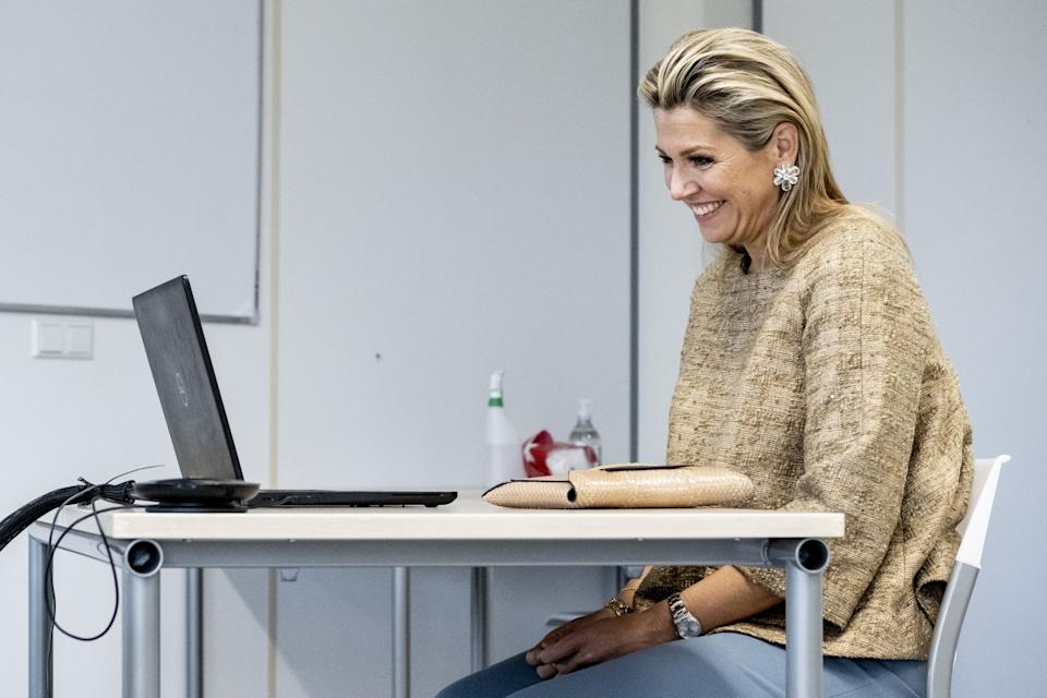 Dutch Queen Maxima smiles in front of a computer during a working visit to MBO Utrecht, in Utrecht, The Netherlands, on November 19, 2020 as the visit focused on the impact of the Covid-19 pandemic , novel coronavirus, on education, internships and the well-being of teachers and students. (Photo by Patrick van Emst / POOL / AFP) / Netherlands OUT (Photo by PATRICK VAN EMST/POOL/AFP via Getty Images)