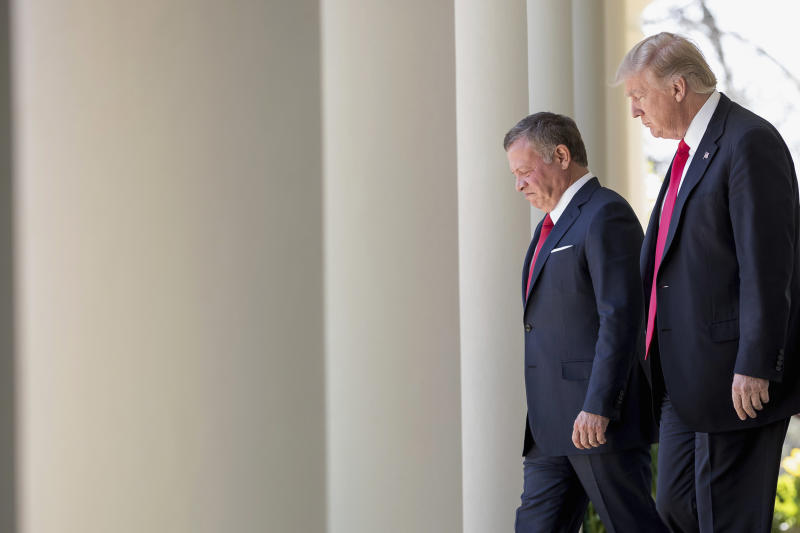 President Donald Trump and Jordan's King Abdullah II arrive for their news conference in the Rose Garden at the White House in Washington, Wednesday, April 5, 2017. (AP Photo/Andrew Harnik)