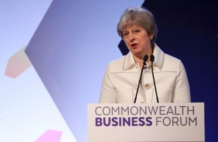 Britain's Prime Minister Theresa May speaks at a Commonwealth Heads of Government Meeting business forum in London