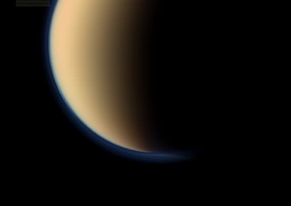 This view shows a close up of toward the south polar region of Saturn's largest moon, Titan, and show a depression within the moon's orange and blue haze layers near the south pole. NASA's Cassini spacecraft snapped the image on Sept. 11, 201