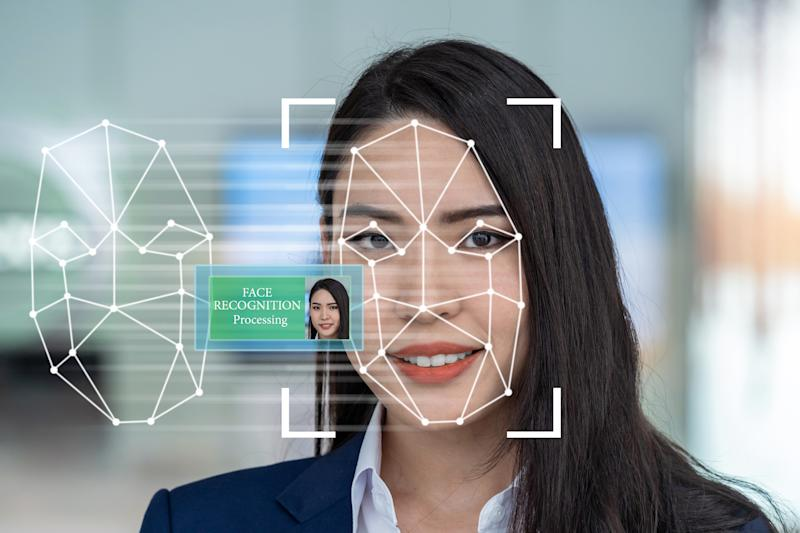 Asian women using Face detection and recognition technology for access permission