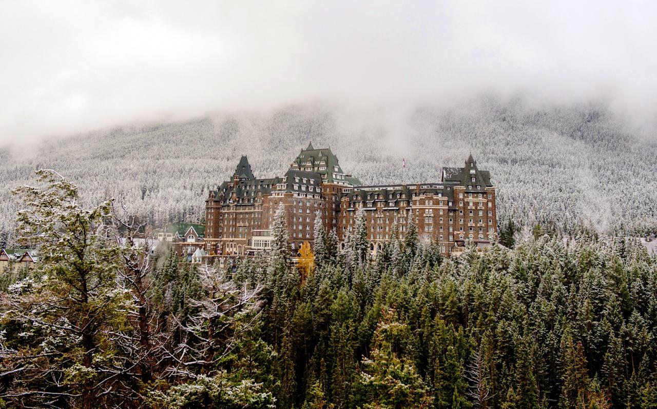 "Built in 1888 to encourage tourism and sell train tickets, this chateau-style hotel sits pretty by the Rocky Mountains in Banff National Park. But it gets a tad more Gothic once you get inside—and we aren't talking about the architecture. <em><a href=""https://calgaryherald.com/life/food/ghosts-and-guests-mingle-at-haunted-hotel-themed-events-at-the-banff-springs-hotel"">The Calgary Herald</a></em> has reported several resident ghosts, including a bride who supposedly fell down the stone staircase during her wedding. But there's a less tragic spirit, too: Sam the bellman, who worked at the hotel until 1975 and claimed he'd come back to haunt the joint. His spirit supposedly pulls shifts helping people with their bags before disappearing."