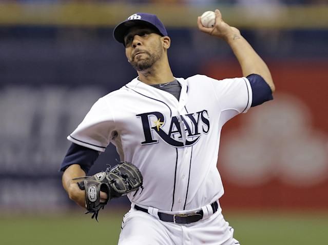 FILE - In this July 25, 2014 file photo, Tampa Bay Rays starting pitcher David Price delivers to the Boston Red Sox during the first inning of a baseball game in St. Petersburg, Fla. The Detroit Tigers added another Cy Young Award winner to their star-studded rotation, acquiring Price from Tampa Bay in a blockbuster deal Thursday, July 31, 2014. (AP Photo/Chris O'Meara, File)