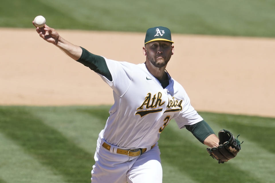 Oakland Athletics' James Kaprielian pitches against the Kansas City Royals during the fifth inning of a baseball game in Oakland, Calif., Saturday, June 12, 2021. (AP Photo/Jeff Chiu)
