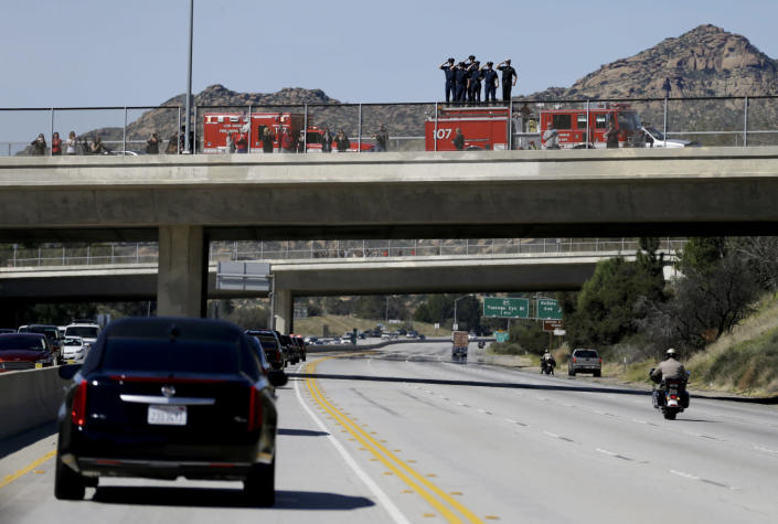 <p>Firefighters salute as the hearse carrying the body of Nancy Reagan makes its way to the Ronald Reagan Presidential Library on Wednesday. <i>(Photo: Jae C. Hong, Pool/AP)</i></p>