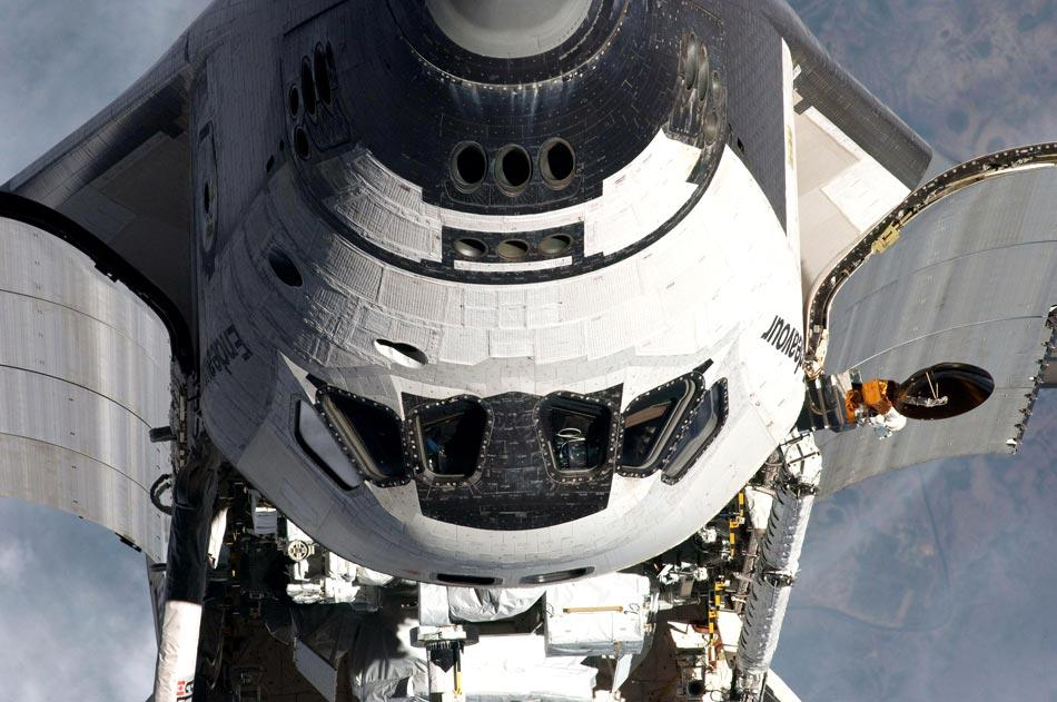 IN SPACE - MAY 18:  In this handout provided by National Aeronautics and Space Administration (NASA), NASA space shuttle Endeavour begins the nine-minute Rendezvous Pitch Maneuver, or 'backflip,' in order to be photographed then dock on its last visit to the International Space Station on May 18, 2011 in space. After 20 years, 25 missions and more than 115 million miles in space, Endeavour is on its final flight to the International Space Station before being retired and donated to the California Science Center in Los Angeles. Capt. Mark E. Kelly, Gabrielle Giffords's husband, will lead mission STS-134 as it delivers the Express Logistics Carrier-3 (ELC-3) and the Alpha Magnetic Spectrometer (AMS-2) to the International Space Station.  (Photo by NASA via Getty Images)
