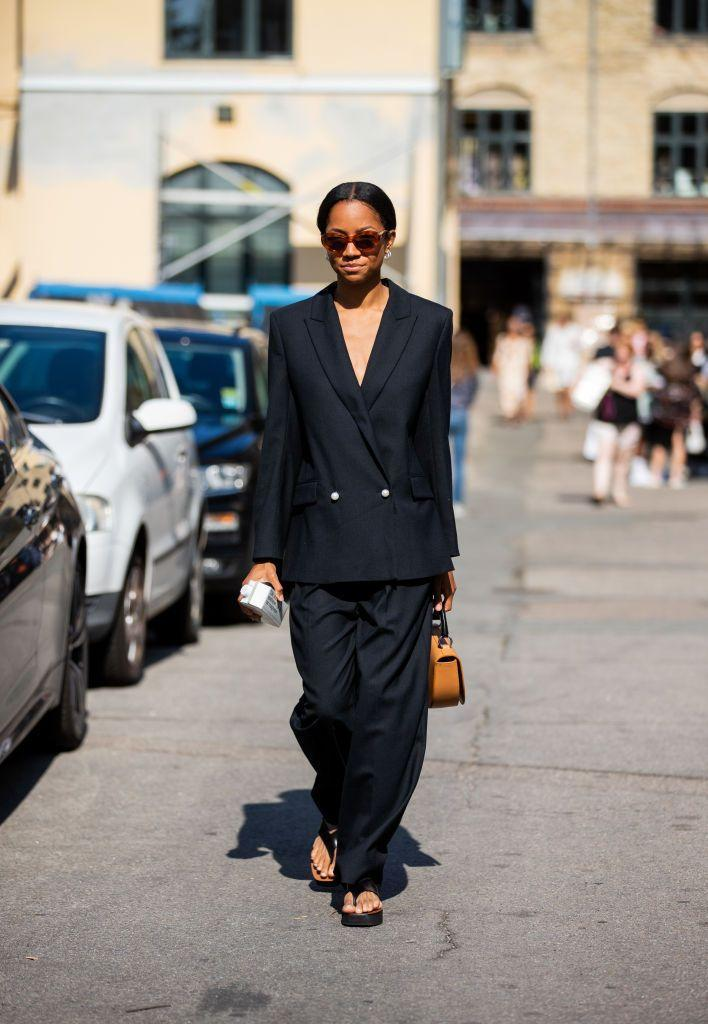 <p>Though a slouchy suit has been making the rounds for a bit, pairing it with easy thong sandals feels like a brand-new idea. </p>