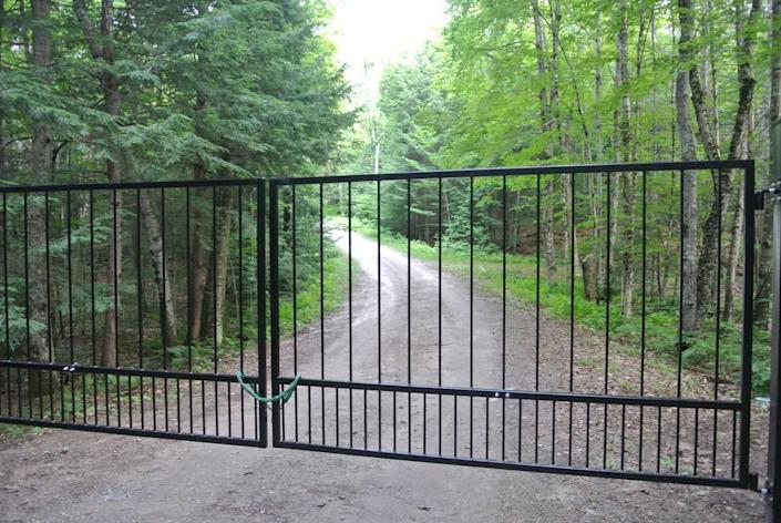 The gate in the long driveway leading to Ghislaine Maxwell's property was shut and locked Thursday afternoon.