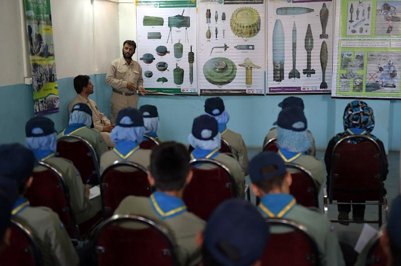 Afghan Scouts listen to a deminer as they attend a class at the Scouts training centre in Kabul