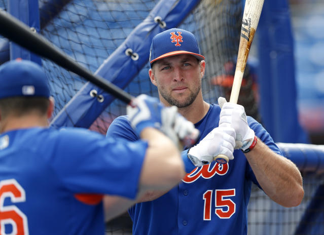 New York fans might want to get accustomed to seeing Tim Tebow in a Mets jersey. (AP Photo)