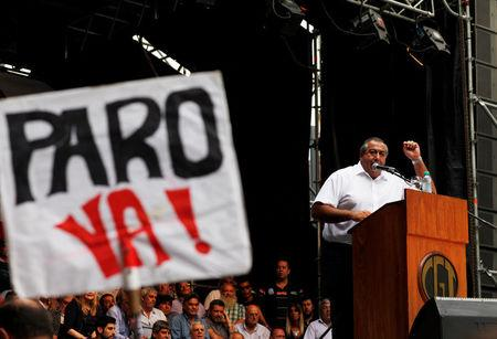"Hector Daer, secretary general of Argentina's National General Confederation of Labor (CGT), addresses the crowd during a broad march in solidarity with striking teachers in Buenos Aires, Argentina March 7, 2017. The sign reads ""Strike now."" REUTERS/Martin Acosta"