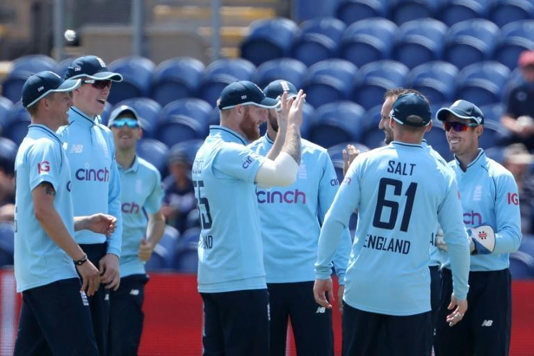 Success - England's Lewis Gregory (R) is congratulated by captain Ben Stokes after dismissing Pakistan's Mohammad Rizwan during the first ODI in Cardiff