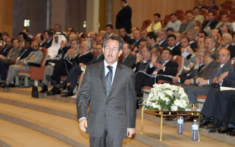 Fawaz Akhras, chairman of the British-Syrian Society and father of Syria's First Lady Asma al-Assad, attends the opening session of the Syrian Banking Conference in Damascus, in 2004 - Credit: LOUAI BESHARA/AFP/Getty Images