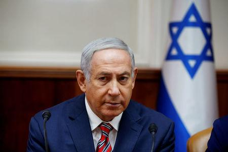 FILE PHOTO: Israeli Prime Minister Benjamin Netanyahu attends the weekly cabinet meeting at the prime minister's office in Jerusalem, June 17, 2018. REUTERS/Ronen Zvulun/Pool