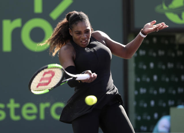 "In this photo taken on Wednesday, March 21, 2018, Serena Williams returns to Naomi Osaka of Japan, during the Miami Open tennis tournament, in Key Biscayne, Fla. Serena Williams' coach says she will play the French Open beginning in two weeks. The tournament will mark the 23-time Grand Slam champion's first major since returning to the tour from maternity leave. Coach Patrick Mouratoglou tells the WTA tour's website, ""Serena will play the French Open to win it."" (AP Photo/Lynne Sladky)"