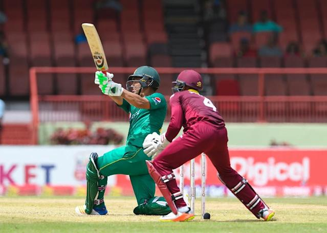 Kamran Akmal of Pakistan (L) hits 4 during the 1st ODI match between West Indies and Pakistan (AFP Photo/Randy BROOKS)