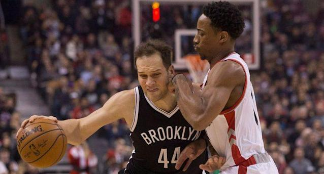 Bojan Bogdanovic drives the lane against Toronto's DeMar DeRozan. (Chris Young/CP)